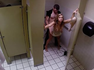 Super-horny bitch and her fucker have coitus in the public restroom