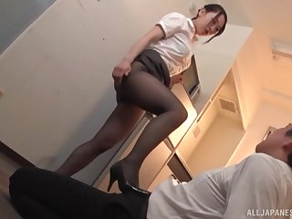 Oiled up Japanese secretary in stockings Kase Kanako in a fetish scene