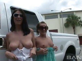These beauties arrive hot posing half naked next to pickup the Big Board