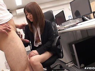 Naughty Asian co-worker Kimoko Tsuji gives a footjob and blowjob in the assignation