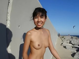 Skinny babe is doing some very naughty swot at bottom the beach, in the middle of the show one's age